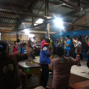 Students rehearsing daibbit dance in the makeshift classroom, Gongshan County, 15 July 2014. (Photo: Ying Diao)
