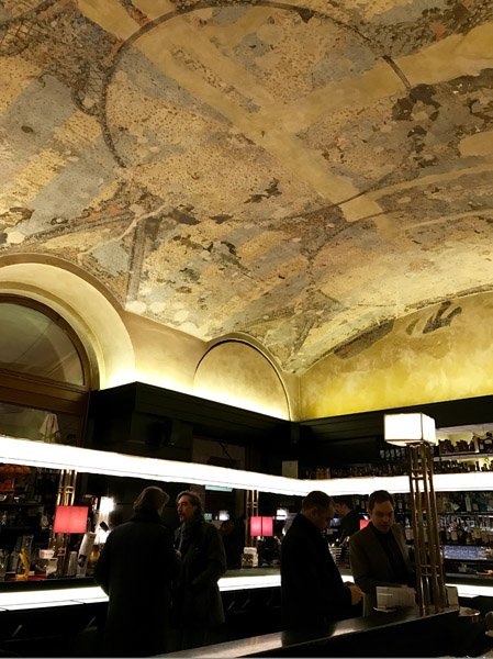 Café Urbanis. On the way from Piazza Borsa to Piazza Unità, there is another historical café, the Urbanis. Opened in 1832, during the latest renovation works, an original fresco was uncovered (in the picture). It's frequented mostly in the evening for its cocktails and aperitifs. (Photo: Giulia Carabelli)